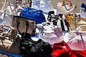 Fake handbags for sale displayed outside Castello Sforzesco (Sforza Castle).