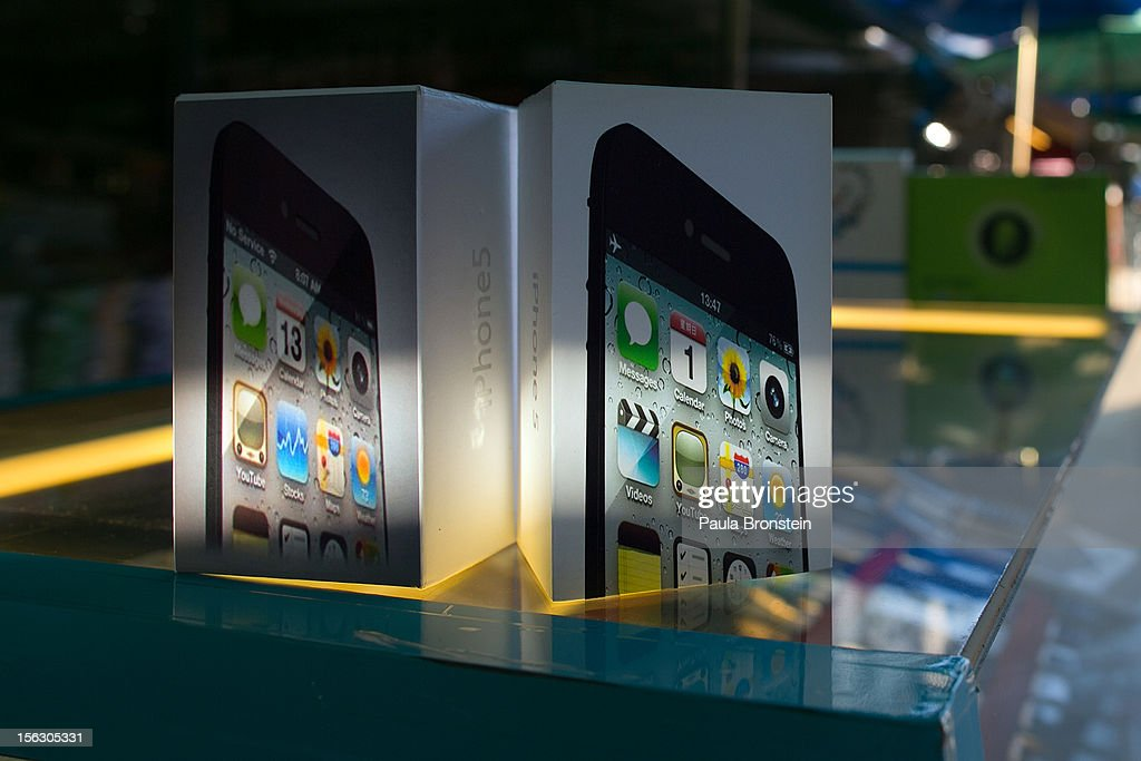 Fake iPhone packaging is displayed on a stall at an outdoor market selling counterfeit Chinese made items in the Golden Triangle, situated along the Thai- Burma border on November 12, 2012 in Tachiliek, Myanmar. Chinese copies boasting well known brands flood this market allowing Thai shoppers and tourists to travel over the border to buy everything from fake iPhones, designer purses, watches and sunglasses.