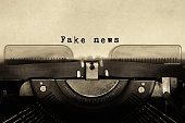 Vintage typewriter with sheet of paper and words 'fake news'.