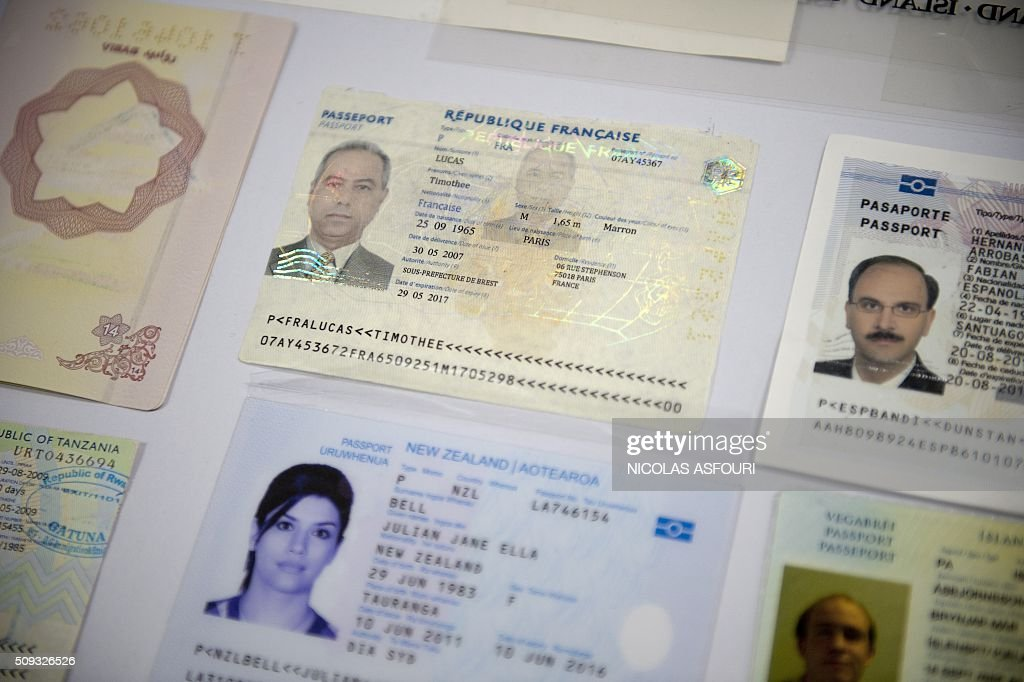 Fake passports are displayed at the immigration bureau in Bangkok on February 10, 2016 after Thai police broke up a major fake passport ring led by an Iranian known as 'The Doctor' which sent thousands of passports to Middle Eastern customers trying to enter Europe. Five years of investigation culminated in the February 8 arrest of the alleged Iranian mastermind, 48-year-old Hamid Reza Jafary, police said. The kingdom has long been a hub for a forged document industry serving human traffickers and other criminals. AFP PHOTO / NICOLAS ASFOURI / AFP / NICOLAS ASFOURI