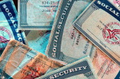 Fake Social Security cards that have been seized but authorities lay in a pile at the office of US Immigration and Customs Enforcement in Charlotte...