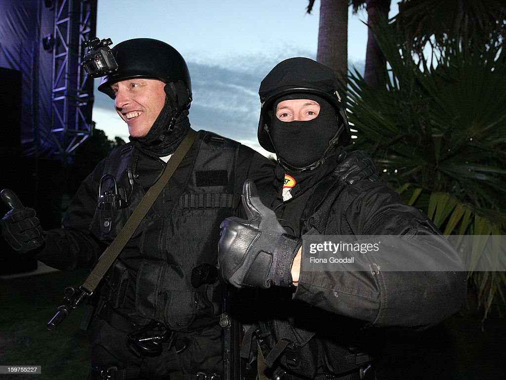 A fake swat team enters the mansion grounds on the first anniversary of the police raid which saw the closure of Megaupload, as Kim Dotcom launches his new file-sharing site, Mega, on January 20, 2013 in Auckland, New Zealand. The launch comes as Dotcom continues to face extradition to the United States on copyright and racketeering charges in relation to his file sharing site, Megaupload.