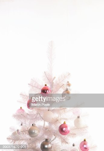 Fake white Christmas tree decorated with baubles, high section : Stock Photo