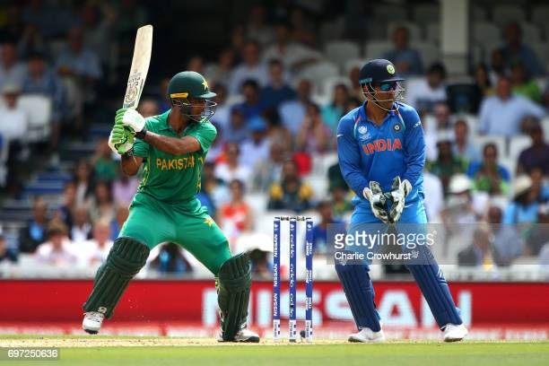 Fakhar Zaman of Pakistan hits out while India's wicket keeper MS Dhoni looks on during the ICC Champions Trophy Final match between India and...