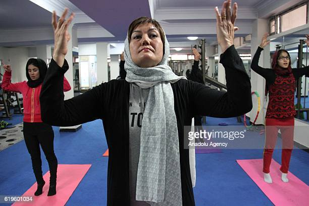Fakhria Momtaz 39 teaches yoga for Afghan women at a yoga club in Kabul Afghanistan on November 1 2016 The first yoga center has opened in the...