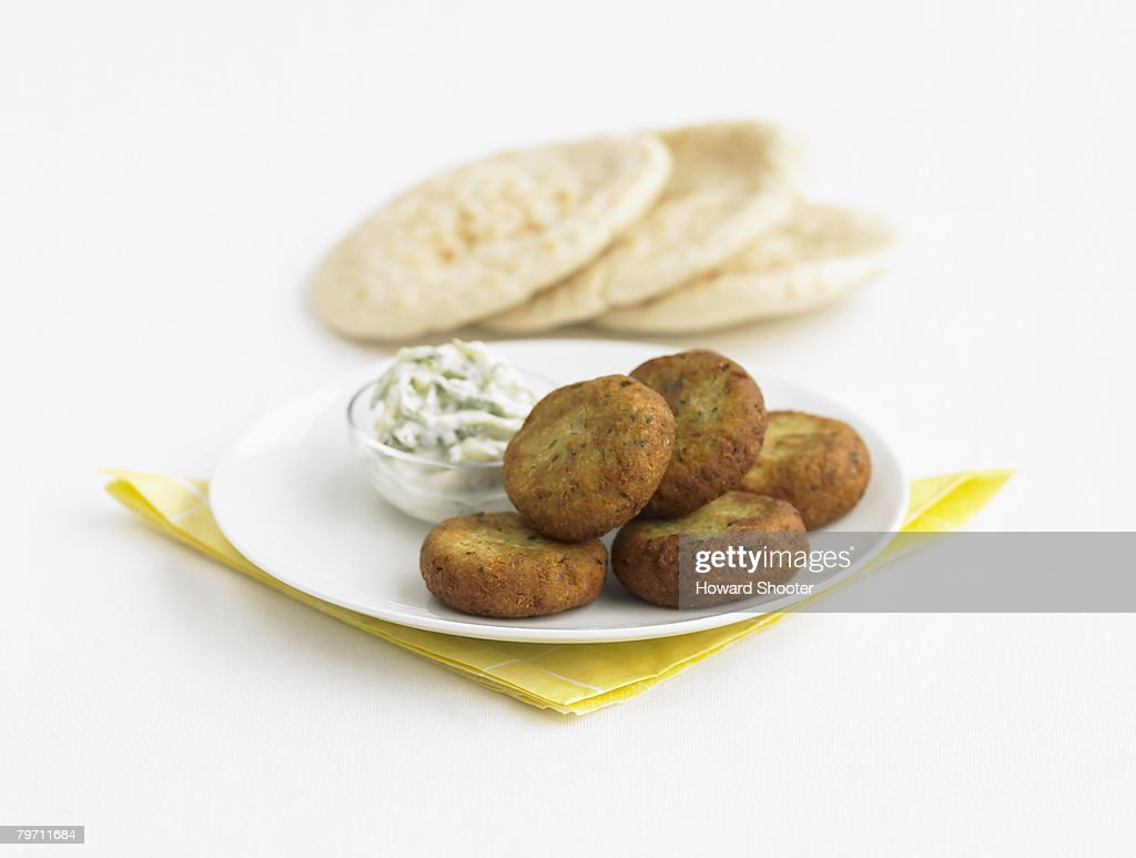 Falafel on a plate with tzatziki and pita bread