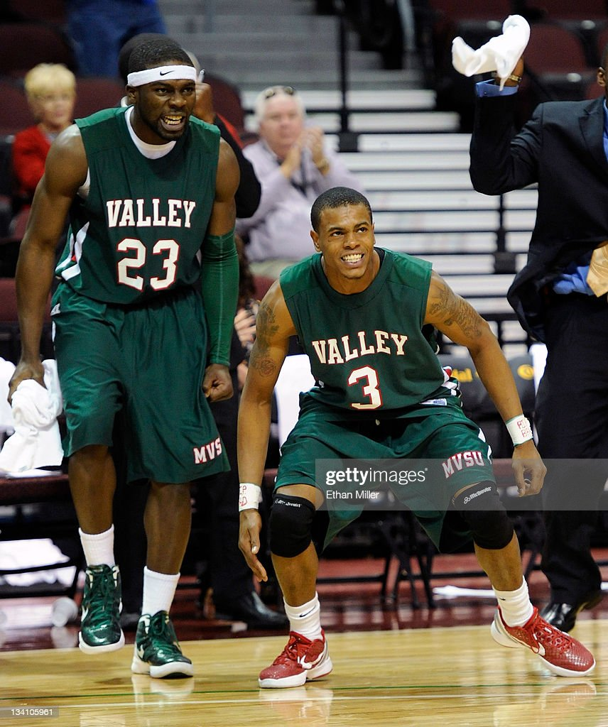 Falando Jones #23 and Terrence Joyner #3 of the Mississippi Valley State Delta Devils react during the team's 90-89 win in double overtime over the Tennessee State Tigers during the third round of the Continental Tire Las Vegas Invitational at the Orleans Arena November 25, 2011 in Las Vegas, Nevada.
