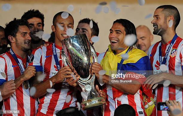 Falcao of Atletico Madrid celebrates with the UEFA Super Cup following the match between Chelsea and Atletico Madrid at Louis II Stadium on August 31...