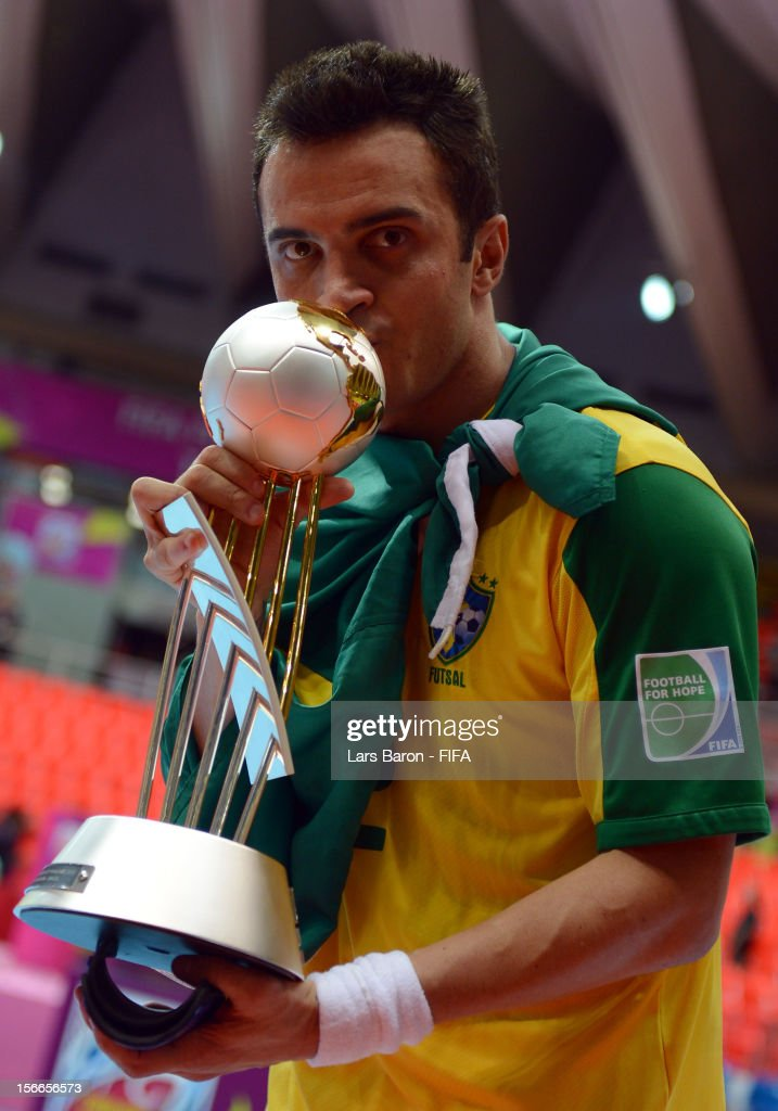 Falcao of Brazil celebrates with the trophy after winning the FIFA Futsal World Cup Final at Indoor Stadium Huamark on November 18 2012 in Bangkok...