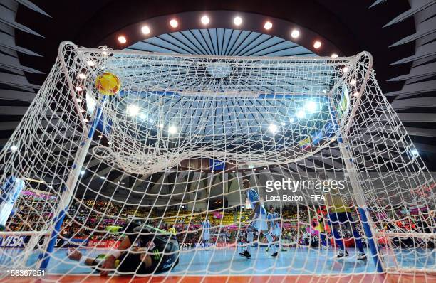 Falcao of Brazil scores his teams winning goal during the FIFA Futsal World Cup QuarterFinal match between Argentina and Brazil at Indoor Stadium...