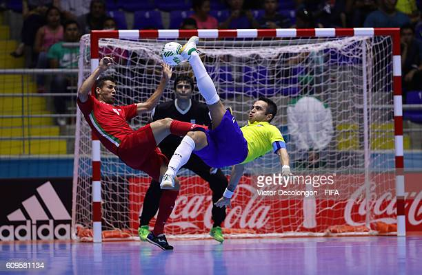 Falcao of Brazil tries for a bicycle kick as Hamid Ahmadi of Iran during round of 16 match play between Brazil and Iran in the 2016 FIFA Futsal World...
