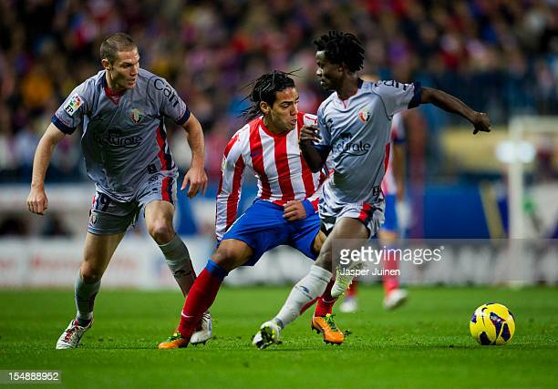 Falcao of Club Atletico de Madrid duels for the ball with Fernando Da Silva and Anthony Annan of Osasuna during the La Liga match between Club...