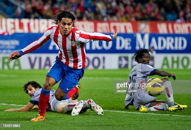 Falcao of Club Atletico de Madrid leaves Anthony Annan and Alejandro Arribas of Osasuna behind during the La Liga match between Club Atletico de...