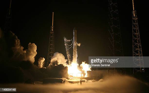A Falcon 9 rocket carrying the Dragon spacecraft blasts off Tuesday May 22 from Complex 40 at Cape Canaveral Air Force Station SpaceX is the first...