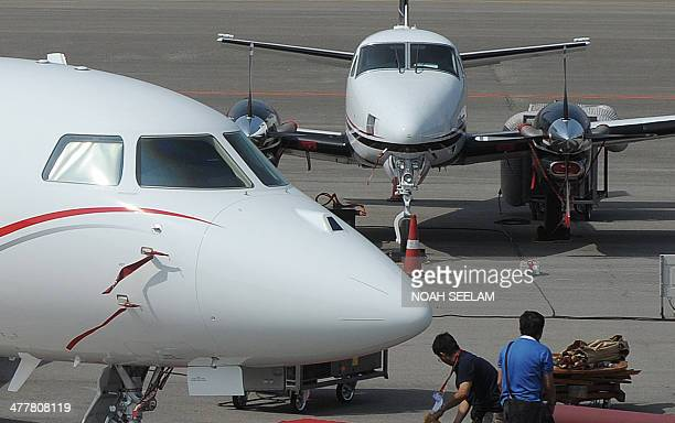 Falcon 900 LX aircraft are parked on display at Begumpet Airport in Hyderabad on March 11 ahead of The India Aviation 2014 show The fourth India...