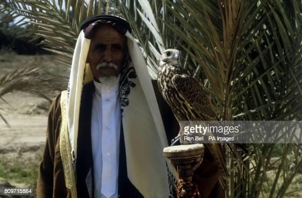 Falcon handler Ali bin Hassan AlMajid AlMaimi at the Salman Centre for the breeding of falcons in Bahrain