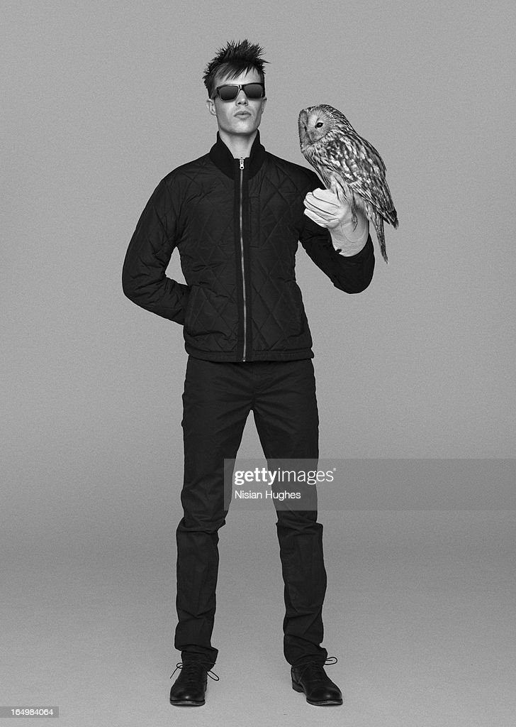 Falconer with owl perched on his glove : Stock Photo