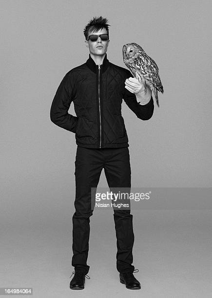 Falconer with owl perched on his glove