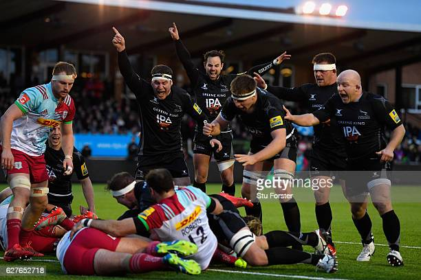 Falcons players Rob Vickers and Michael Young celebrate the try of Mark Wilson during the Aviva Premiership match between Newcastle Falcons and...