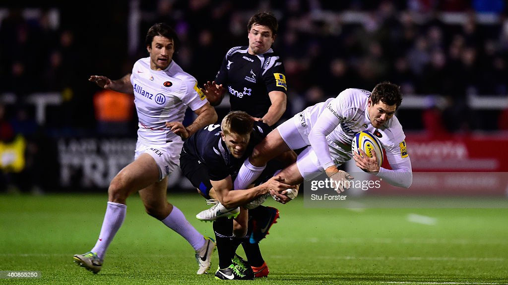 Falcons replacement Chris Harris tackles Saracens full back Alex Goode during the Aviva Premiership match between Newcastle Falcons and Saracens at...