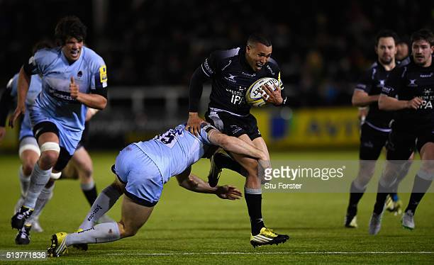 Falcons wing Marcus Watson is tackled by Warriors full back Chris Pennell during the Aviva Premiership match between Newcastle Falcons and Worcester...