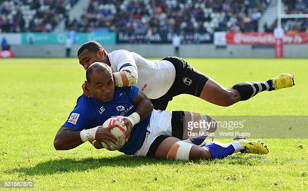Falemiga Selesele of Samoa dives over for the winning try as he is tackled by Leone Nakarawa of Fiji during the Cup Final match between Fiji and...