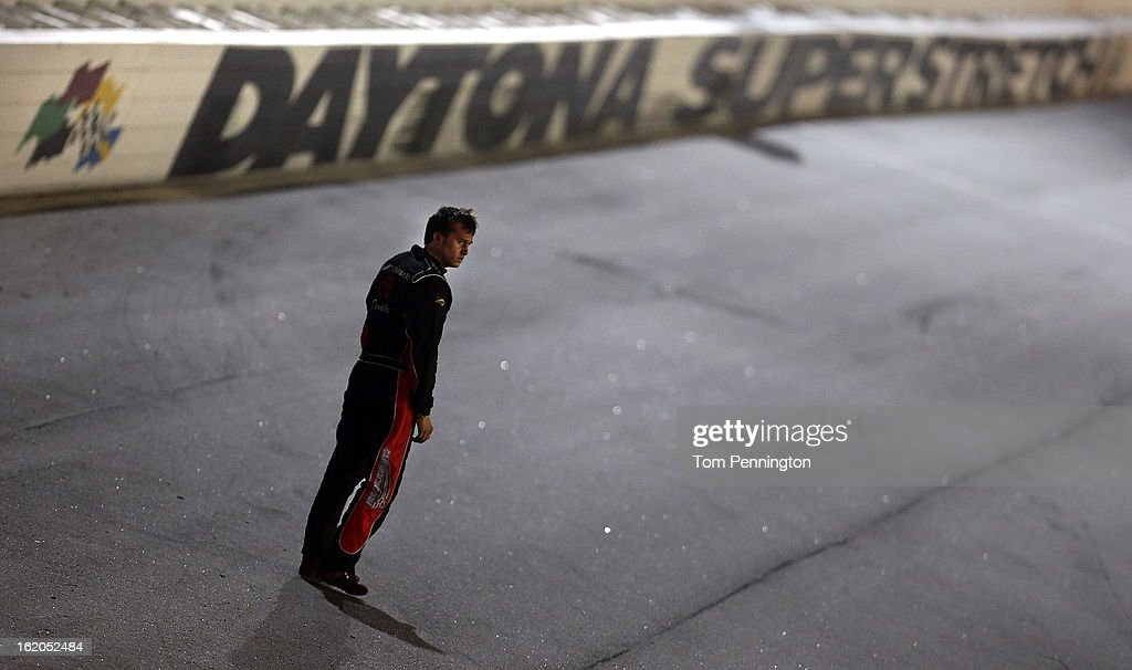 C.E. Falk III, driver of the #40 Hampton Roads Toyota Dealers Toyota, stands on the track in disgust after being wrecked on the final lap while leading during the NASCAR Whelen All-American Late Model UNOH Battle At The Beach at Daytona International Speedway on February 18, 2013 in Daytona Beach, Florida.