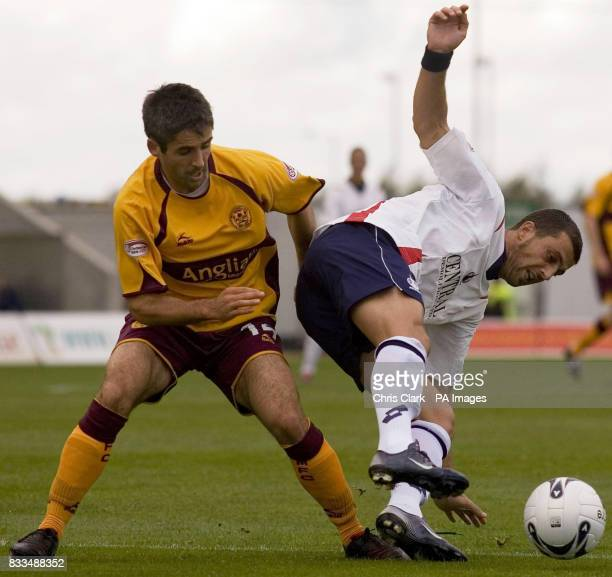 Falkirk's Pedro Moutinho shields the ball from Motherwell's Keith Lasley during the Clydesdale Bank Scottish Premier League match at Falkirk Stadium...