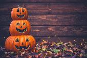 Fall celebrations. Halloween Jack O Lanterns with leaves