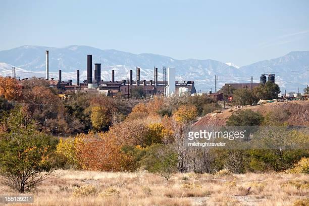 Fall colors with Pueblo's Colorado Steel Mill smoke stacks horizontal