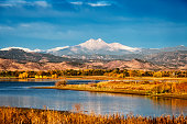 A spectacular view of Longs Peak across Macintosh lake in the fall.