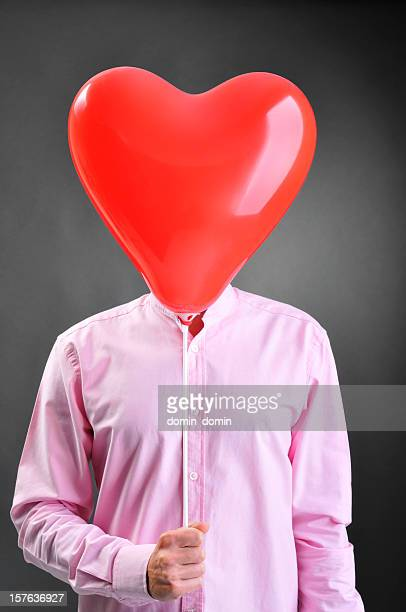 Fall in love man has heart-shaped balloon instead of head