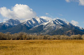 The first snow of the season is draped across the shoulders of Mount Princeton in the Collegiate Peaks Range of the Rocky Mountains near Buena Vista, Colorado.  Fall colors are still visible in the ha