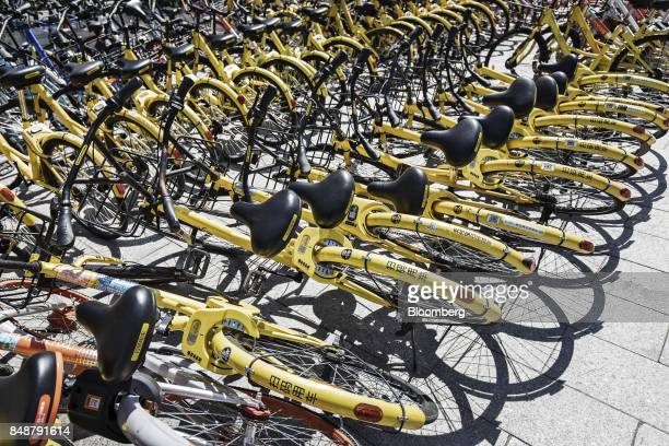 Fallen Ofo Inc bicycles lie on the sidewalk outside a subway station in Shanghai China on Thursday Sept 12 2017 Across Chinese cities sidewalks are...
