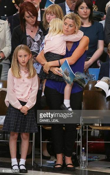 Fallen police officer Dave Phillips' wife Jen and daughters Abigail and Sophie attend the National Police Memorial Day Service at St Paul's Cathedral...