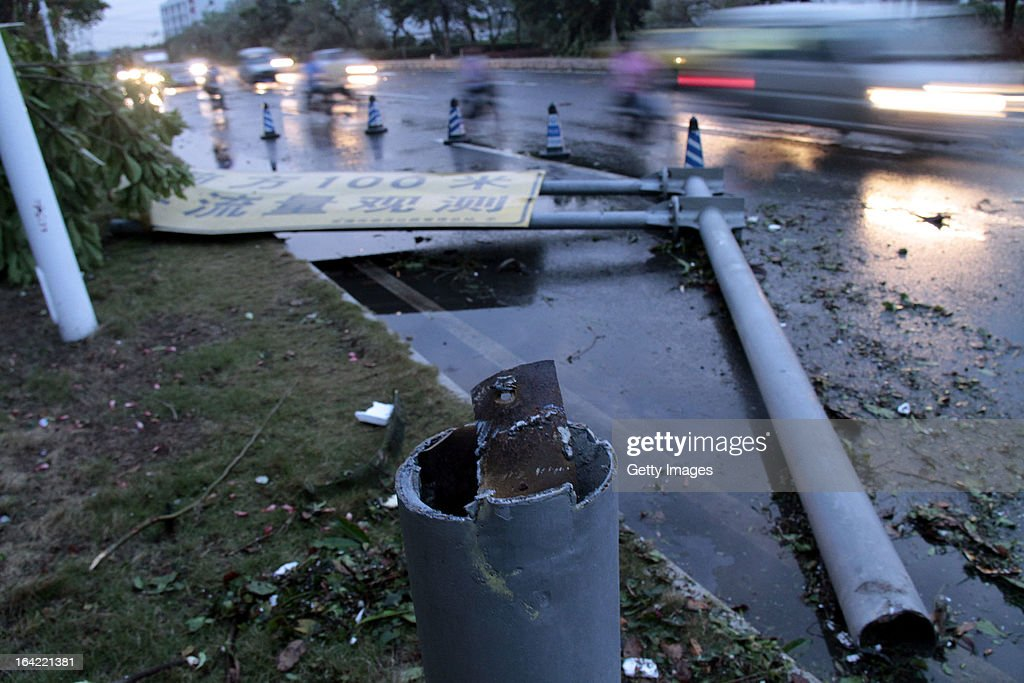 A fallen road sign lies on the ground on March 20, 2013 in Dongguan, China. Nine people have been killed and about 272 others injured after a thundersand hailstorm swept Dongguan city on Wednesday afternoon.