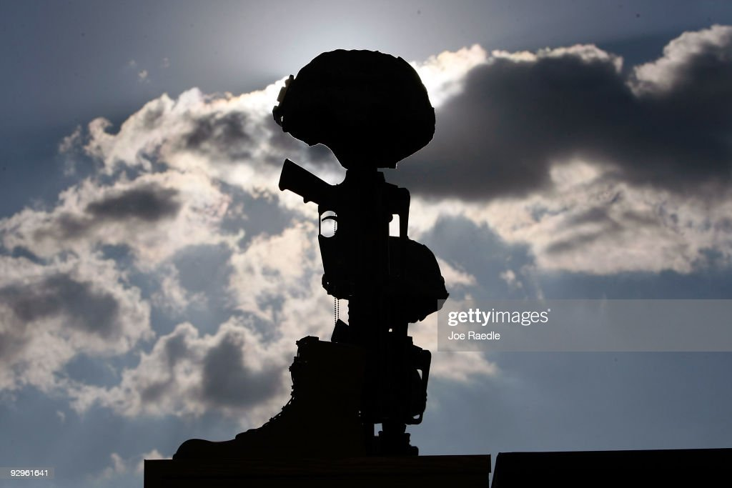 A fallen soldiers memorial is seen during the memorial service that US President Barack Obama and first lady Michelle Obama attended for the thirteen...