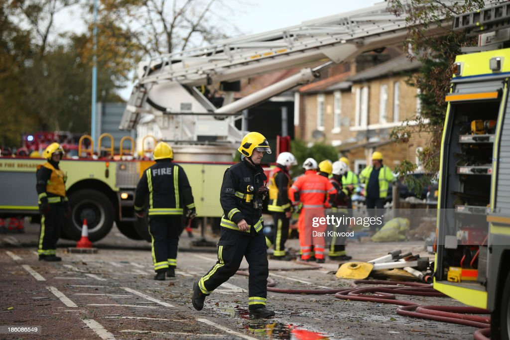 A fallen tree has caused a devastating gas explosion in west London, destroying three homes in Bath Road, Hounslow on October 28, 2013 in London, England. Approximately 220,000 homes are without power and two deaths have been recorded after much of southern England has been affected by a severe storm. Transport links on road, rail, air and sea have been severely disrupted by hurricane-force winds that have almost reached 100 mph in places.