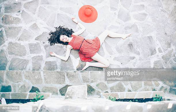 Fallen woman body lying on ground