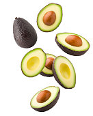 Falling avocado, clipping path, isolated on white background full depth of field