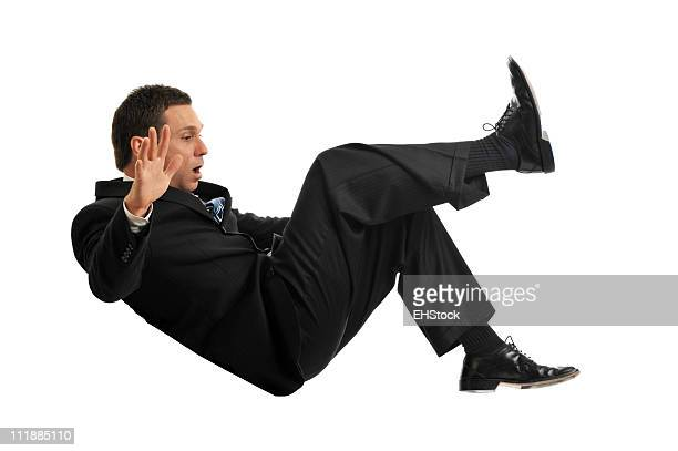Falling Businessman on White