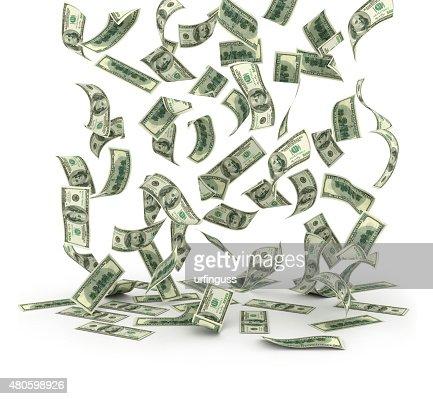 Falling dollar bills on white background : Stock Photo