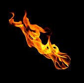 Falling fireball of hot flames isolated on black