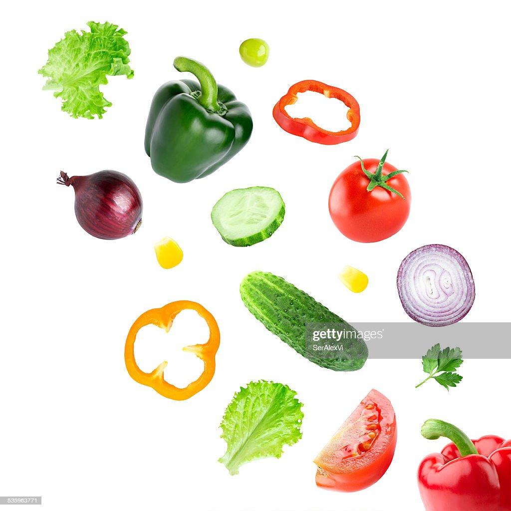 Falling fresh vegetables : Stock Photo