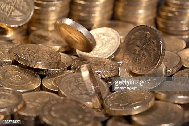 Falling one pound coins, money series