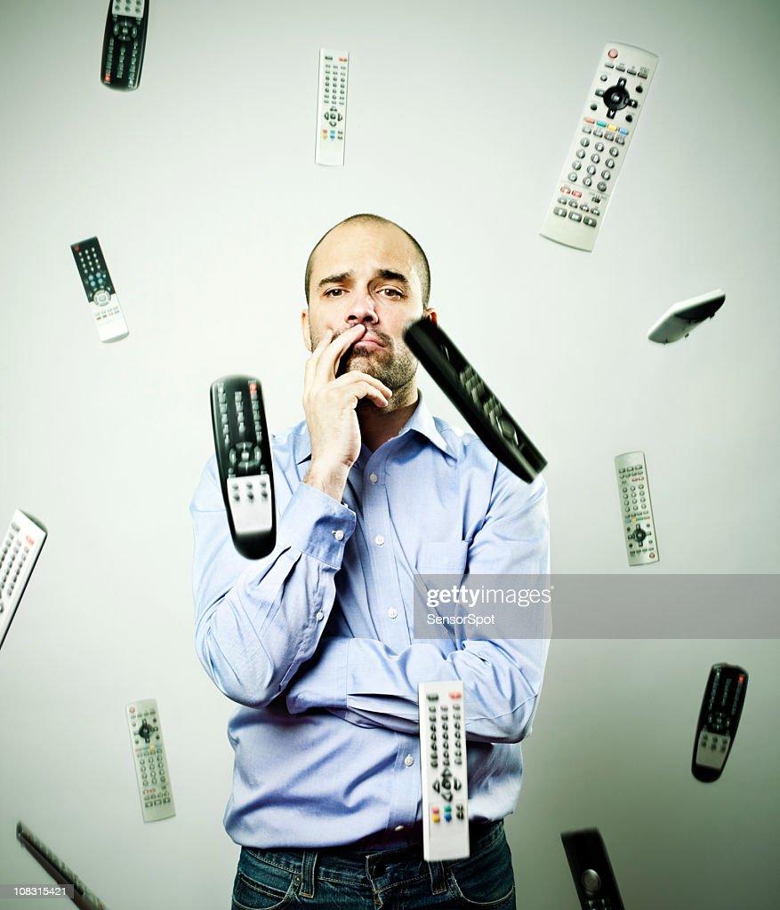 Falling remote controls : Stock Photo
