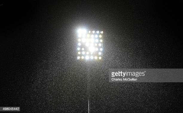 Falling snow is illuminated by a floodlight before the European Champions Cup Pool 1 rugby game at Kingspan Stadium between Ulster and Saracens on...