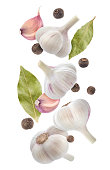 Garlic, allspice and bay leaf isolated on white background with clipping path. Spices collection
