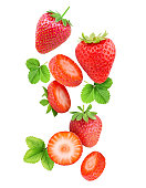 Falling strawberries isolated on white background with clipping path; leaf