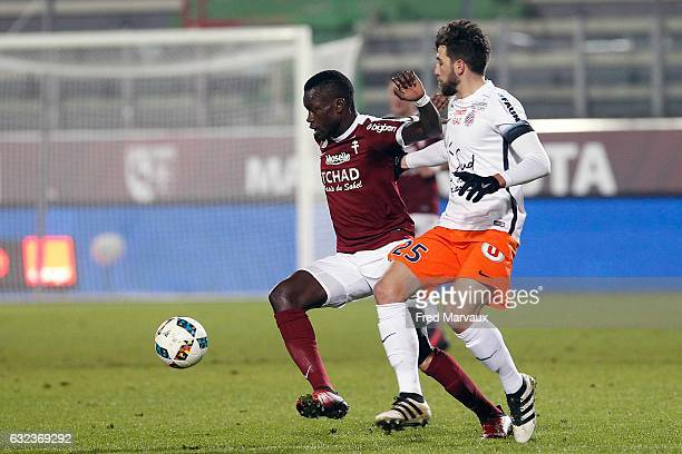 Fallou Diagne of Metz and Mathieu Deplagne of Montpellier during the French Ligue 1 match between Metz and Montpellier at Stade SaintSymphorien on...